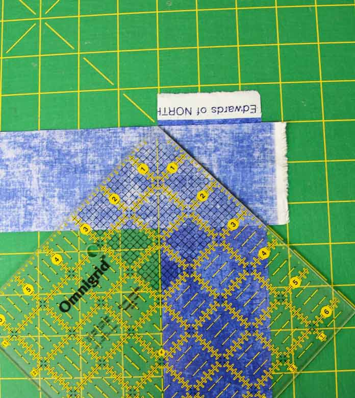 Using a square ruler to help join the binding strips