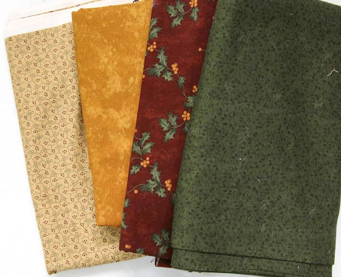 Four different fabrics that could work for the sashing.