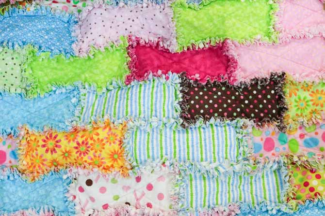 Seams on the rag quilt have frayed for a nice soft texture