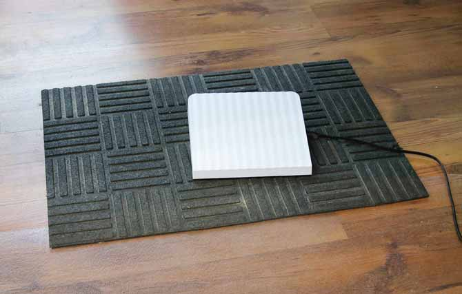 Sewing machine foot pedal on an outdoor mat to prevent runaway foot pedal