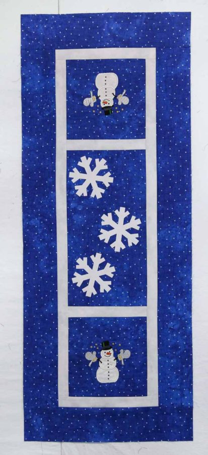 Auditioning snowflakes on the table runner