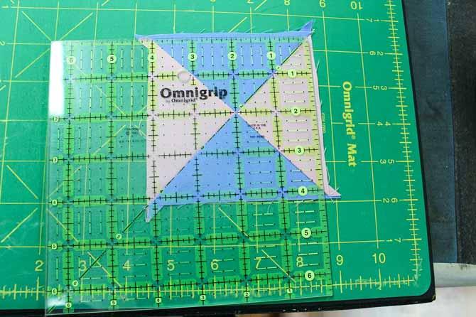 Preparing to square up the quarter square triangle unit