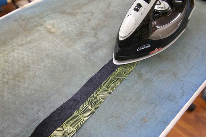 Press the seam from the front to make sure that the seam is well pressed with no tucks.