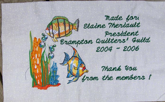 Quilt label with an embroidered motif to match the fish on the quilt front