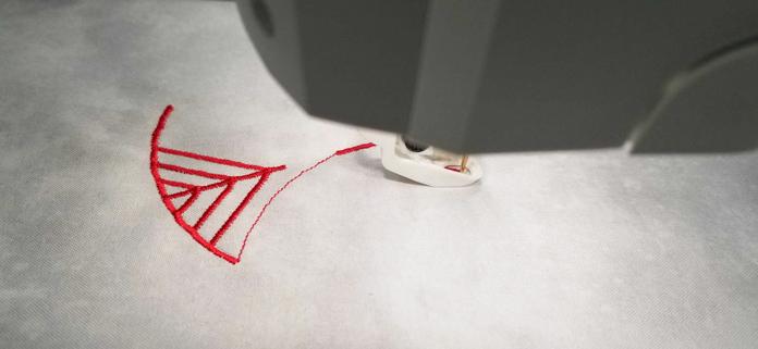 Starting the stitch out process on the HUSQVARNA VIKING Designer Brilliance 80 sewing machine