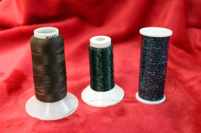 Threads that have a tendency to be unruly: fine threads, invisible thread and metallic thread.