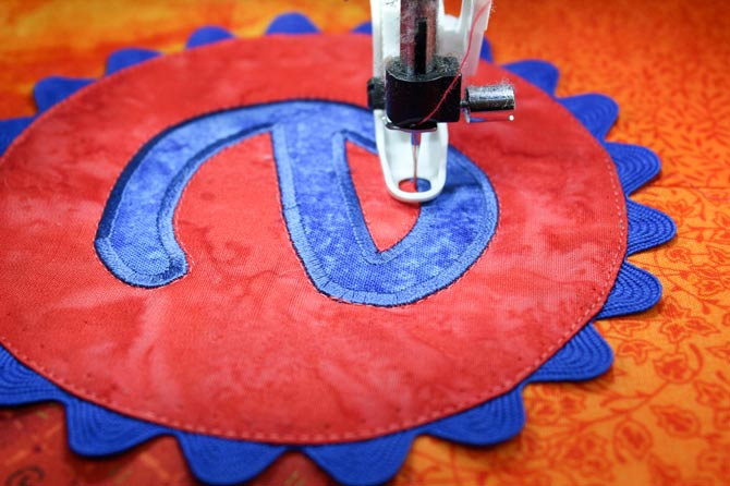 Free motion quilting the monogrammed applique