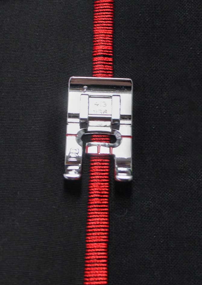 Because of the grooved back, Presser Foot B is able to glide over the applique stitches