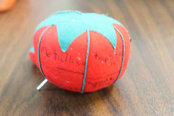 Tomato pincushion used to store partially used needles