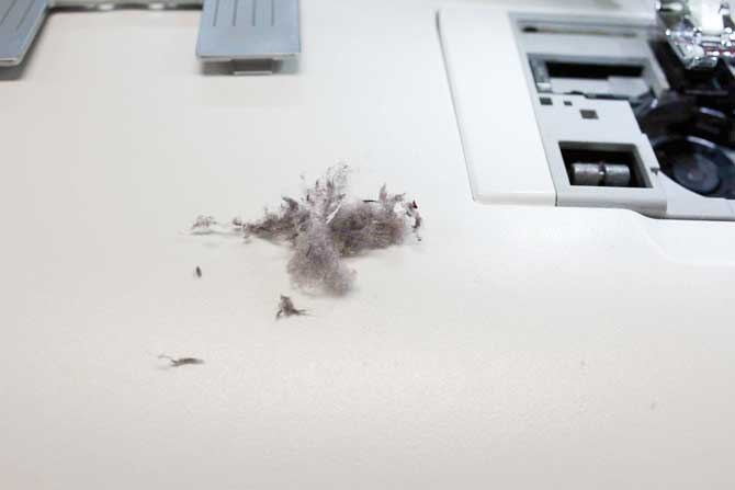 I used the brush to remove this lint. Imagine what that will do to the tension of the sewing machine. Bad news!