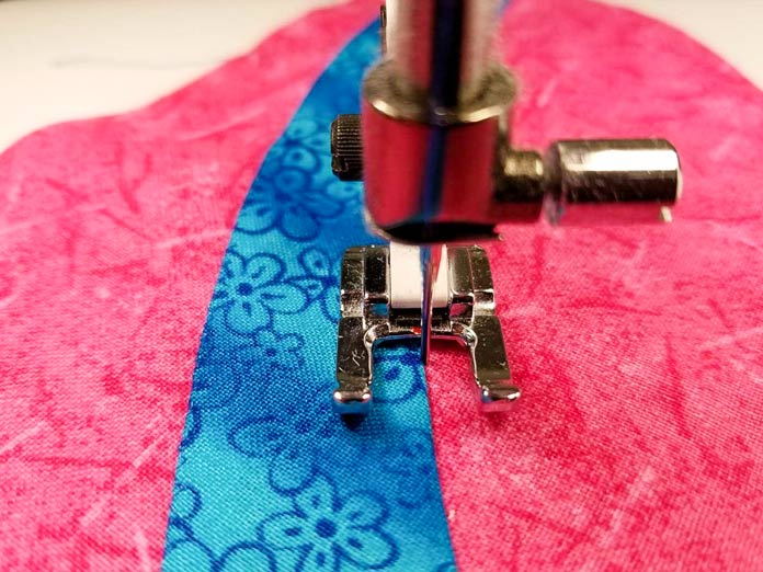 With invisible applique, 99% of the applique stitch is on the applique shape