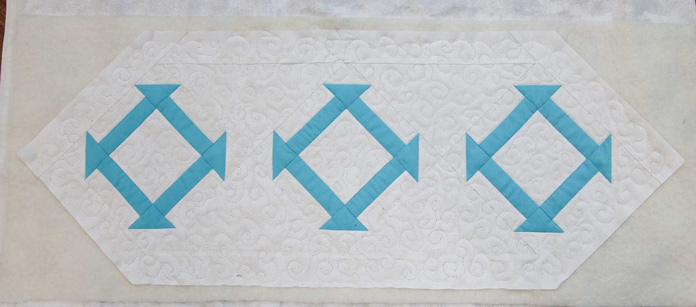 The front of the quilted table runner