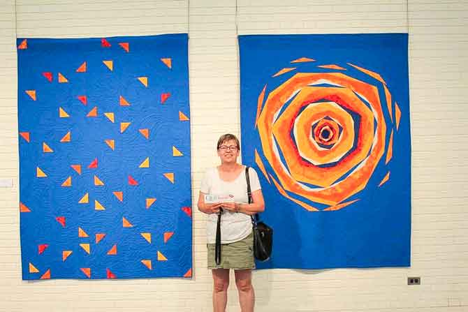 Heather Hochbaum and two of her spectacular quilts