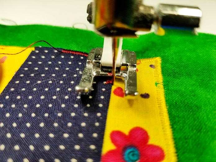 With satin stitch, 99% of the applique stitch is on the applique shape