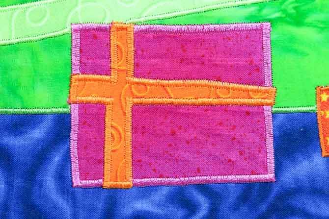 The applique shape is completely stitched