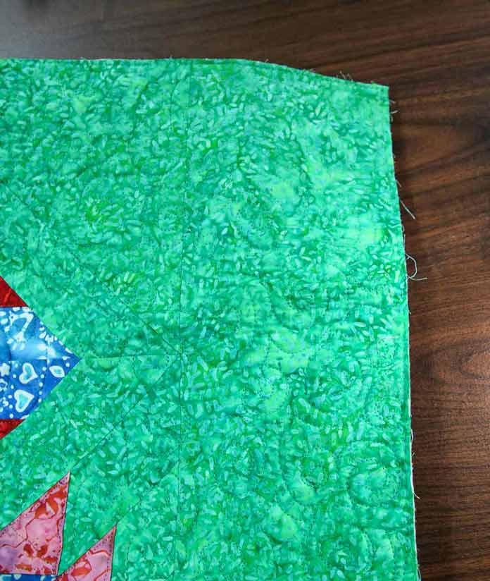 There's a lot of green in the background of this quilt