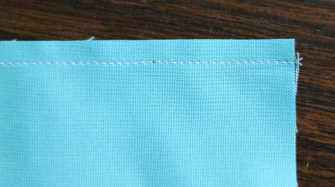 The width of the seam allowance at the end of the seam is consistent with the width of the seam allowance in the middle
