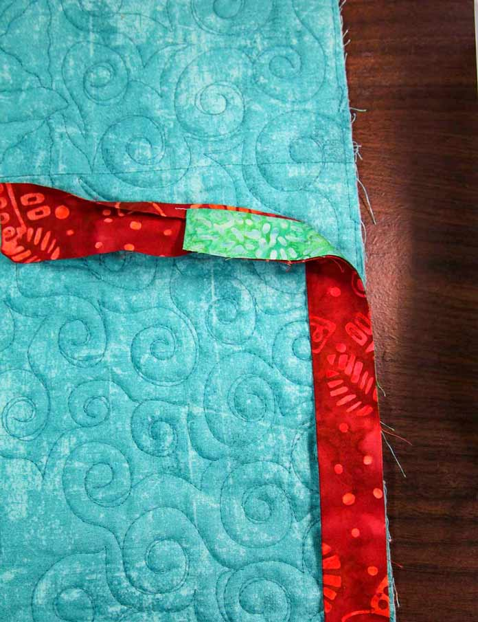 Start stitching the binding to the back of the quilt with the flange facing UP