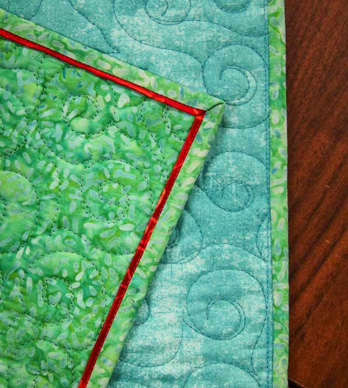 A beautiful colored flange on the front of the quilt and you can barely notice the stitching on the backing