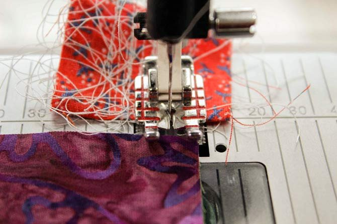 Start your seam on a scrap of fabric to prevent tangling on the underside of your work
