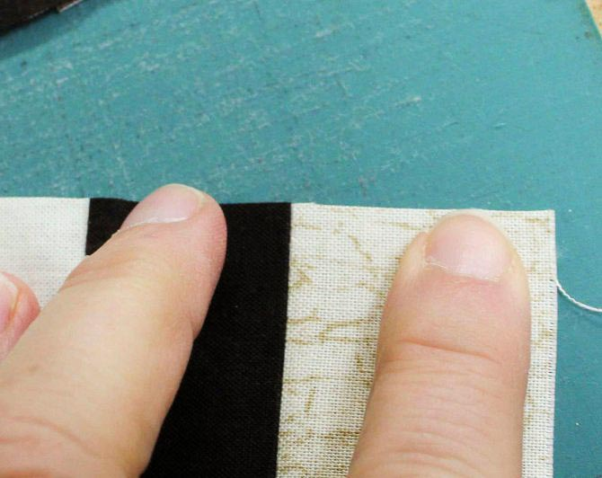 "Even when ""stretched"", the end of the seam allowance is secure with 2.0 stitch length"