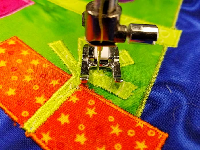 Pivot with the needle on the applique shape so you don't get gaps in the satin stitch