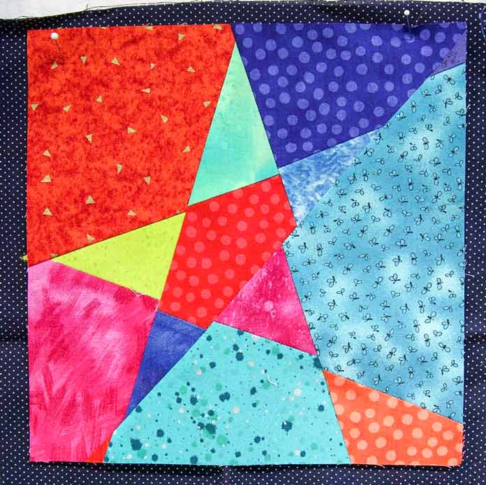Blue dot fabric has a different style to it than the saturated colors in the wonky star block.