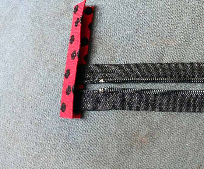The zipper tape at the other end is also too long. Just trim them off so the end of the zipper fits nicely into the zipper tab.