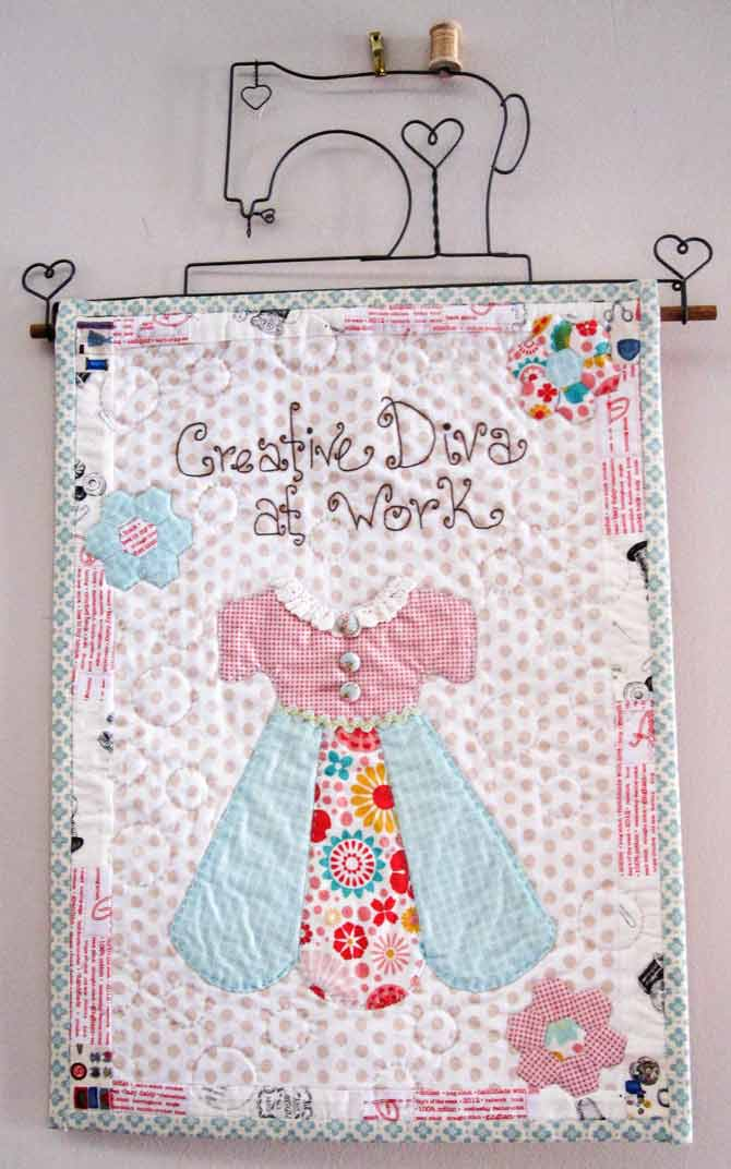 Ready for the reveal: the Darling Diva is finished and hanging on the wall. Like all darling divas, she's sweet and just a bit sassy!