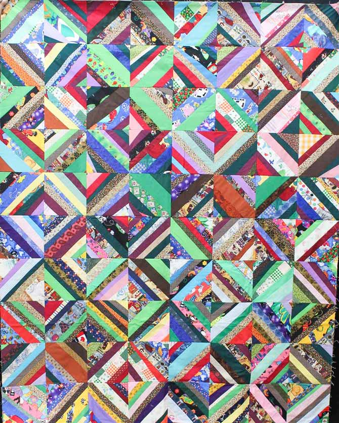 String pieced quilt with an eclectic mix of fabrics