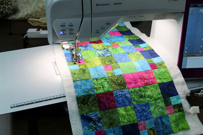 Large work area to the right of the needle makes for easier quilting.