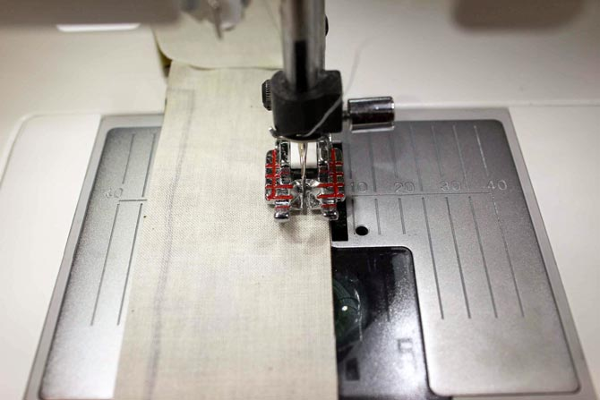 "See how the fabric is positioned to the left of the edge of the Quilter's 1/4"" Piecing foot P"
