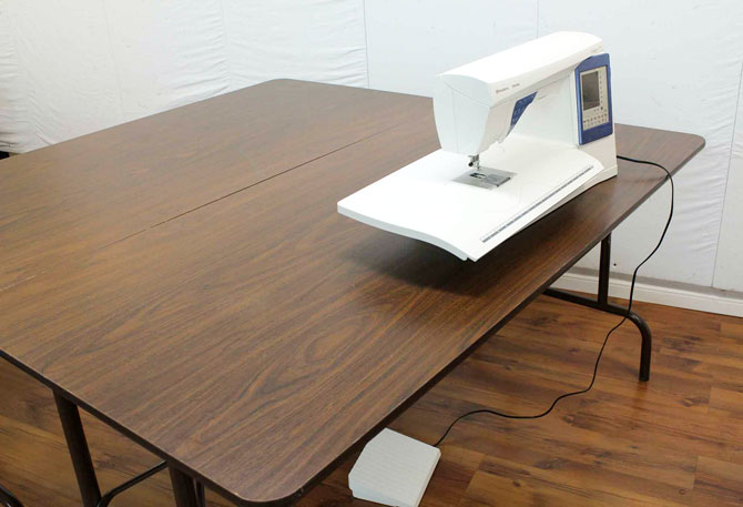 Two 5-foot banquet tables provide a 5-foot square work surface.
