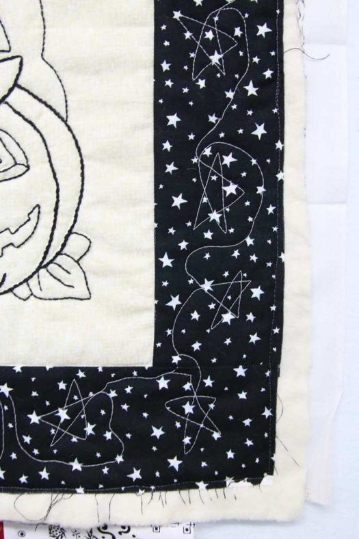 Quilted stars in the border using glow in the dark thread.