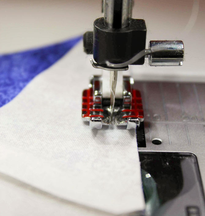 "The Quilter's 1/4"" piecing foot sewing a seam on woven medium fabric"