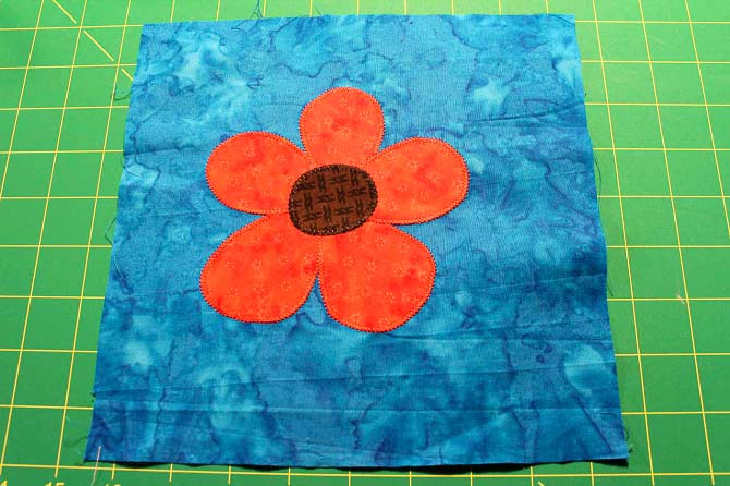 I used this posie block to make it into a journal cover at the retreat.