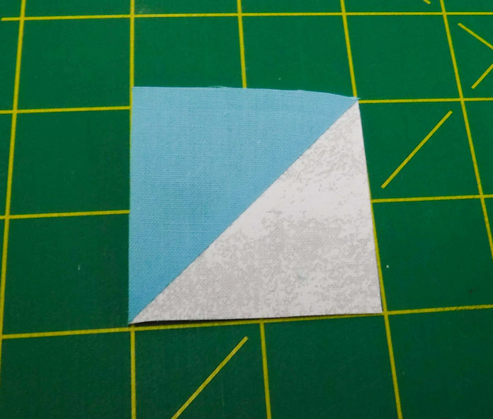 Truly it is, I just happened to be in a weird spot when I took a photo of it - A perfect half square triangle unit