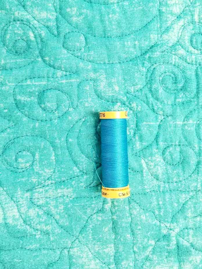 Thread used for the bobbin when sewing the binding to the quilt - it's not an exact match