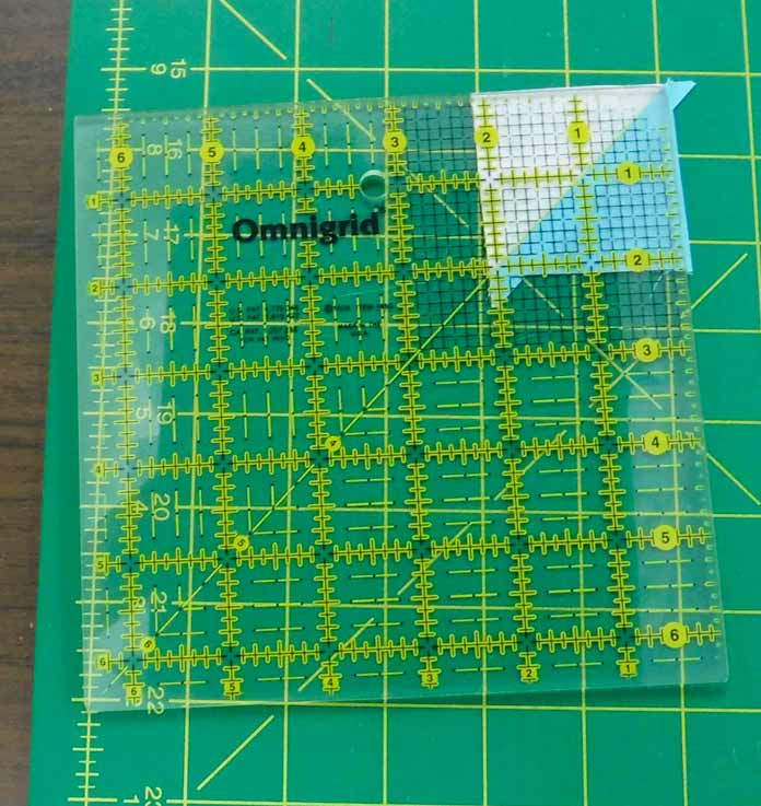 """A 6 ½"""" ruler is perfect for trimming half square triangles"""