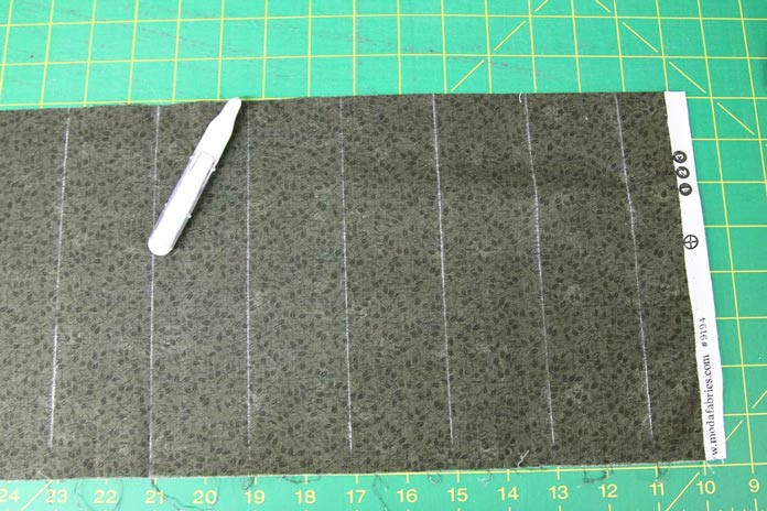 The fabric is marked every two inches with chalk for stitching guidelines.