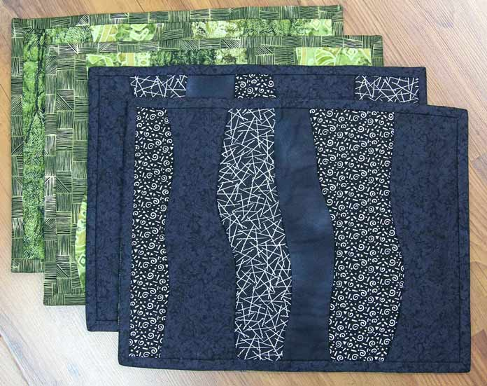 A set of four completely reversible placemats