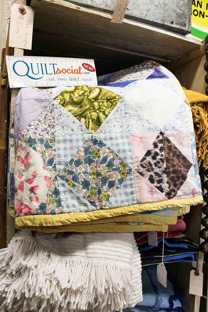 Quilts in an antique shop