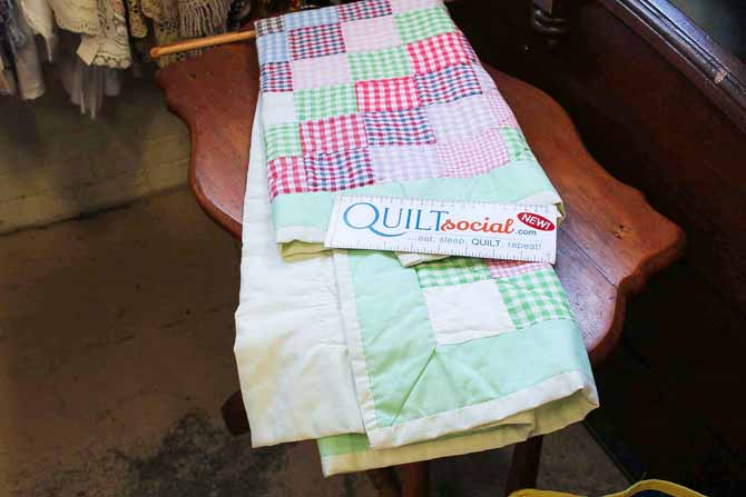 Quilts in an antique shop are hidden treasures
