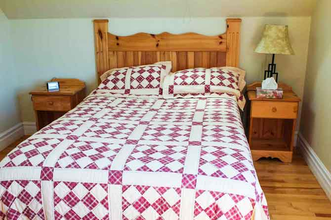 A quilter can never resist renting a room with a stunning quilt on the bed. It always makes her feel at home.