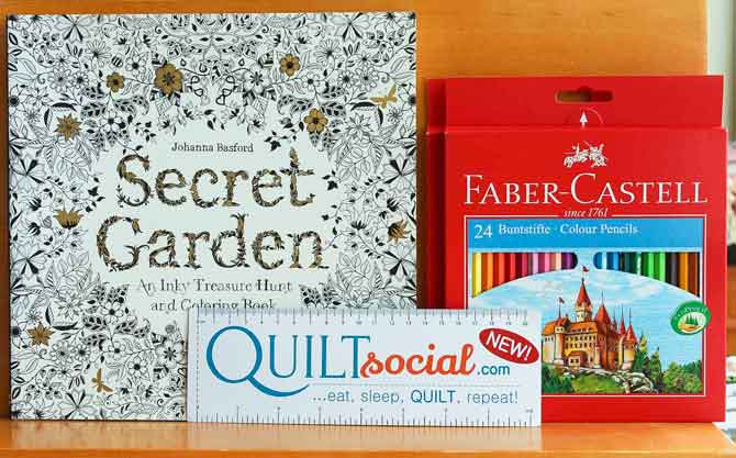 Adult coloring book and pencil crayons