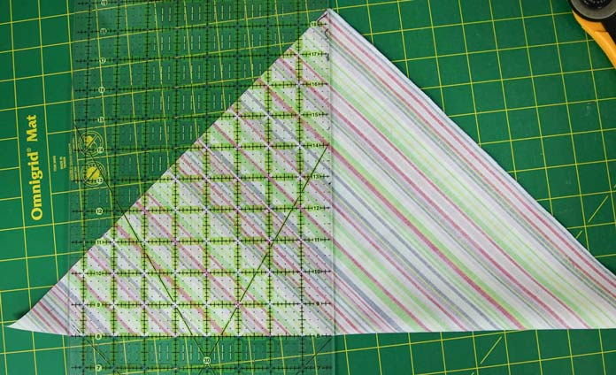 Folding the square in half to make it easier to cut the square on the diagonal