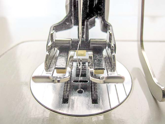 Install your machine's quilting foot, according to the manufacturer's instructions.