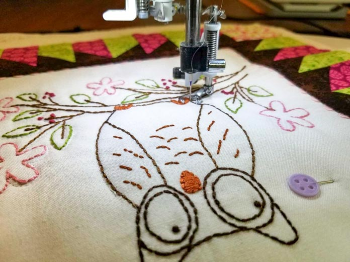 Stitching in the ditch beside the lines of hand embroidery stitches