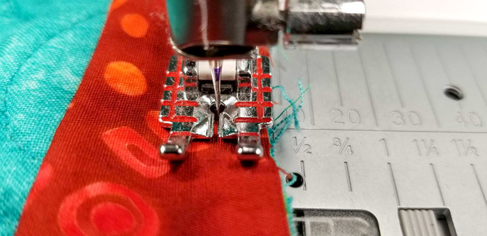 "My seam allowance is slightly larger than ¼"" (using the Quilter's ¼"" piecing foot as a guide)"