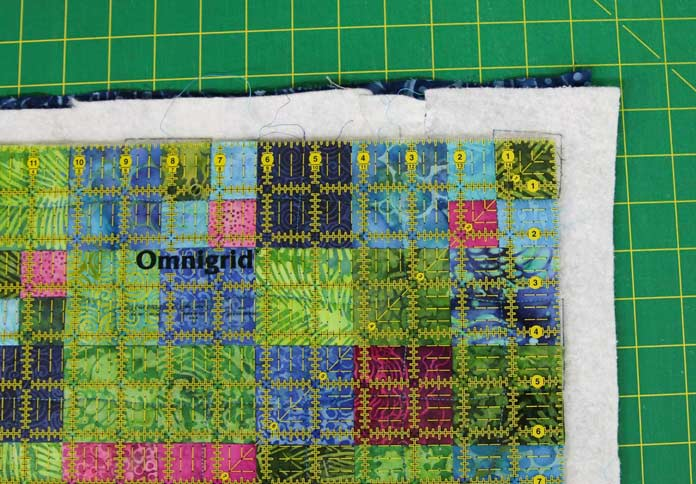 Start in a corner with a square ruler when trimming a quilt.